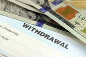 Closeup of bank withdrawal slip with US currency