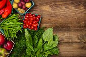 stock photo of farmers  - Fresh farmers market fruit and vegetable from above with copy space on brown wood - JPG