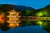 pic of gazebo  - Nice japanese wooden gazebo is shortly after the sunset reflecting in the water - JPG