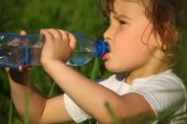 picture of drinking water  - closeup portrait of drinking girl in grass - JPG