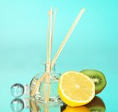 Aromatic sticks for home with fruity odor on blue background