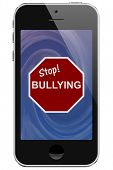 stock photo of stop bully  - Cell Phone with Stop Bullying Message isolated on a white background - JPG