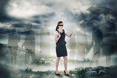 foto of blindfolded man  - Redhead businesswoman in a blindfold against stormy sky with tornado over landscape - JPG