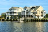 foto of beach-house  - Two luxury beach houses as seen across the canal - JPG