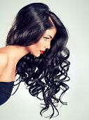 picture of flowing hair  - Model brunette with beautiful long curled hair and red lips - JPG