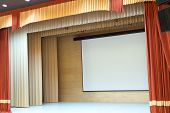 stock photo of cinema auditorium  - Image of cinema auditorium with blank screen - JPG