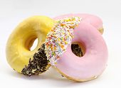 pic of collate  - Several surrounded sweet donuts decorated white background - JPG