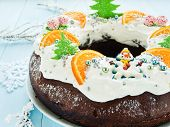 foto of tangerine-tree  - Chocolate Christmas cake with candies tangerine and whipped cream - JPG