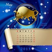 stock photo of taurus  - Simple monthly page of 2015 Calendar with gold zodiacal sign against the blue star space background - JPG