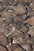 stock photo of pumice-stone  - Lava stone pathway background texture - JPG