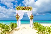 picture of wedding arch  - wedding arch and set up on beach - JPG