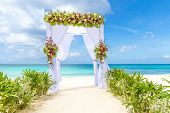 foto of cabana  - wedding arch and set up on beach - JPG