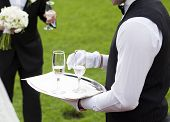 stock photo of waiter  - Waiter serving champagne  - JPG