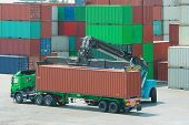 picture of lift truck  - Crane lifter handling container box loading to truck - JPG