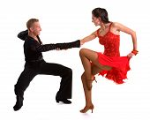 stock photo of ballroom dancing  - Young ballroom dancers in formal costumes posing against a solid background in a studio - JPG