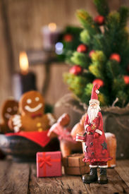 stock photo of gingerbread man  - Christmas background. Santa Claus with Christmas tree presents and gingerbread man.