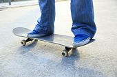 picture of skateboarding  - closup of young skateboarder skateboarding legs at skatepark - JPG