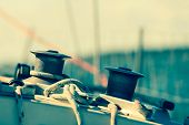 stock photo of yacht  - Winch capstan with rope on sailing boat - JPG