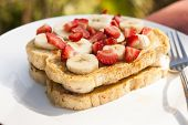 pic of french toast  - French toast with fresh fruit served outdoors on a white plate - JPG