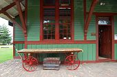 stock photo of caboose  - A 20th century train depot with an old chest and a cart - JPG