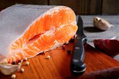 pic of salmon steak  - Delicious portion of fresh raw salmon steak slices with spices - diet healthy food and cooking concept ** Note: Shallow depth of field - JPG