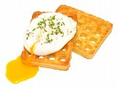 image of yolk  - Single poached egg with runny yolk on potato waffles isolated on a white background - JPG