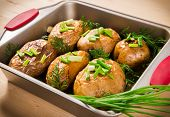 picture of baked potato  - close up of baked potatoes with green onion in oven tray - JPG