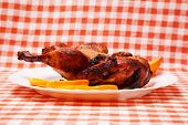 stock photo of roast duck  - Roast duck with oranges on kitchen tablecloth - JPG