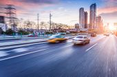 stock photo of bus driver  - Car driving on freeway at sunset - JPG