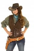 stock photo of cowgirls  - a cowgirl with her hands on her hips looking down - JPG