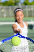 Постер, плакат: Tennis Woman tennis player showing ball and racket on tennis court outside Female tennis player