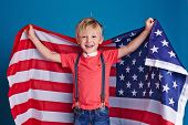 foto of cheers  - Little boy cheering with American flag - JPG