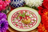 picture of poblano  - Chile en Nogada Mexican dish made from a poblano chile with a fried egg cover walnut sauce and pomegranate seeds for flavor shot with shallow focus lens - JPG