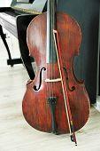 picture of cello  - Cello near piano - JPG