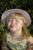 image of misbehaving  - young girl sticking her tongue out at the camera - JPG