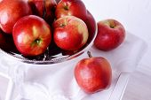 stock photo of serving tray  - Tasty ripe apples on serving tray on brick wall background - JPG