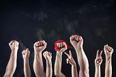foto of revolt  - Clenched fists raised in protest - JPG