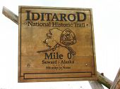 stock photo of sled dog  - Historical marker placed at the sight of the beginning of the 1st Iditarod  - JPG