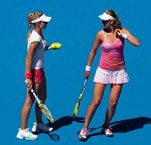 MELBOURNE, AUSTRALIA - JANUARY 28: Maria Kirilenko of Russia (L) with partner Victoria Azarenka of B