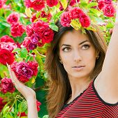 picture of beautiful face  - beautiful woman in garden with roses - JPG