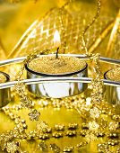 stock photo of happy holidays  - festive candle with golden ribbon - JPG