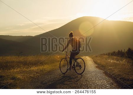 Cycling In Sunset Lifestyle Concept