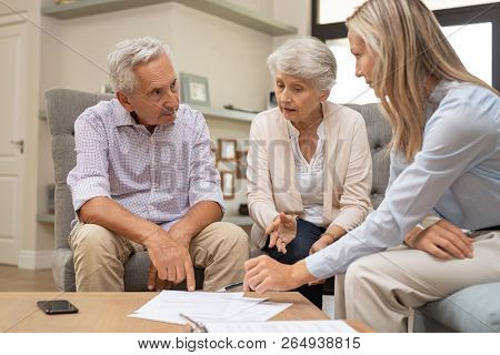 poster of Business agent planning with a retired couple their future investment opportunities. Financial advis