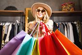 Rich Pretty Blonde Shopaholic Woman Wearing Sunglasses And Fashion Hat Holding Many Colorful Shoppin poster