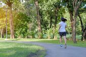 Young Fitness Woman Running In The Park Outdoor, Female Runner Walking On The Road Outside, Asian At poster