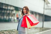 Woman In Shopping. Happy Woman With Shopping Bags And Credit Card Enjoying In Shopping. poster