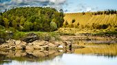Sandy Hills. Lake In The Sandy Canyon. Warm Colors Background. Yellow Sandstone Textured Mountain, W poster