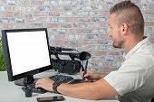 A Man Video Editor With Graphic Tablet And Professional Video Camera poster