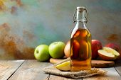 Apple Vinegar. Bottle Of Apple Organic Vinegar Or Cider On Wooden Background. Healthy Organic Food.  poster