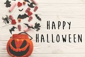 Happy Halloween Text Sign, Flat Lay. Jack O Lantern Bucket With Holiday Candy, Bats,spiders, Skulls  poster